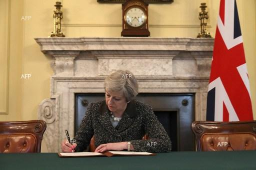 British Prime Minister Theresa May, signs the official letter to European Council President Donald Tusk, invoking Article 50 and signalling the intention of the United Kingdom to leave the EU, March 29, 2017.