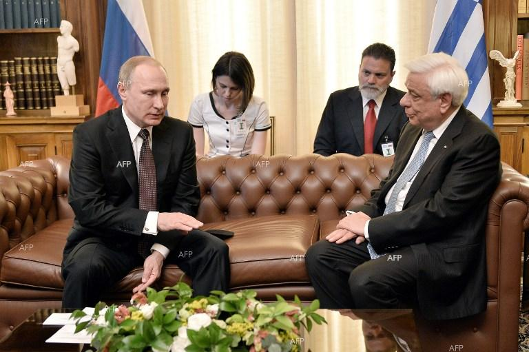 Russian President Vladimir Putin meets with Greek counterpart Prokopis Pavlopoulos in Athens.