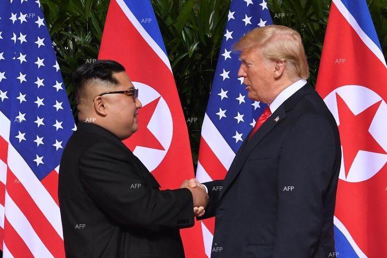 AFP Trump Kim in historic handshake