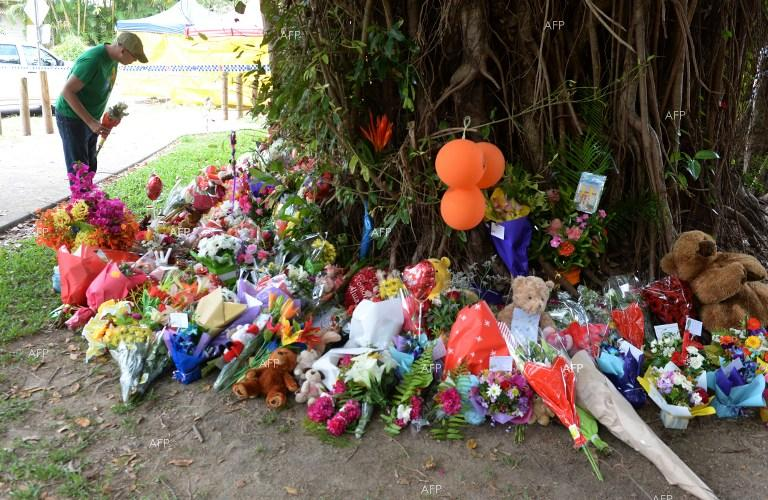 Australia. People brought flowers and toys near the house in Cairns, where eight killed children were found