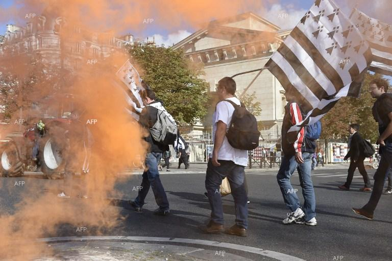 French farmers stage protests in Paris.