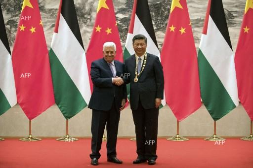 Chinese President Xi Jinping meets with Palestinian colleague Mahmoud Abbas July 19, 2017;