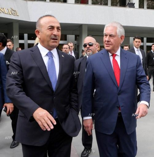 Turkish Foreign Minister Mevlut Cavusoglu (L) and US Secretary of State Rex Tillerson arrive for a meeting in Ankara on March 30, 2017.