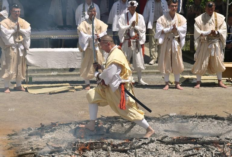 A Buddhist monk walks on fire during a festival in Japan.
