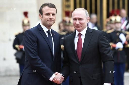 Emmanuel Macron welcomes Vladimir Putin at Versailles Palace. May 29, 2017