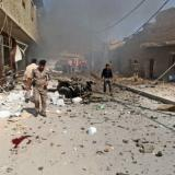 Iraq forces find burned bodies of 12 police in recaptured town