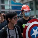 Hong Kong government, democracy protest leaders begin talks