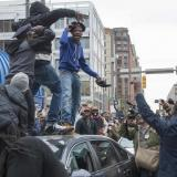 Thousands cheer in Baltimore after officer charges