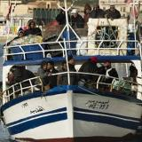 Rescued migrants disembark from Open Arms in Lampedusa: AFP