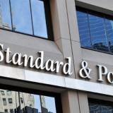 S&P cuts Russia rating a notch to BBB-, outlook negative
