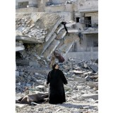 15 dead as Israeli shell hits school sheltering Gazans