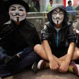 Anonymous attack Greek central bank, warns others