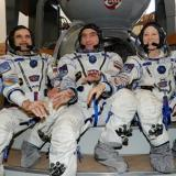 U.S.-Russian space trio lands safely despite bad weather