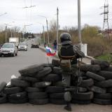 Ukraine army column in east disarms before pro-Russians