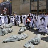 Families of 43 missing Mexicans promise protests over holidays