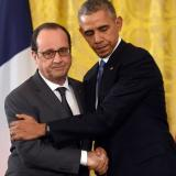 Obama uses tough new language as he stands with French president after Paris attacks and says 'Americans will not be terrorized': The Daily Mail