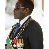Zimbabwe's Robert Mugabe turns up to university graduation ceremony