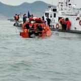 Death toll from sunken ferry rises as search continues
