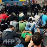 Migrants refuse to get off train to go to Hungarian camp: AFP