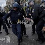 Thousands of police, troops called up to quell Baltimore riot