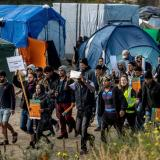 Armed militia groups Attack migrants in Calais Jungle as race tensions reach boiling point: Daily Express