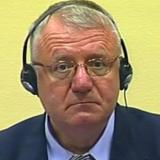 Suspected Serb war criminal Seselj burns Croatia flag