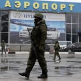 Armed men seize another military airport in Ukraine's Crimea