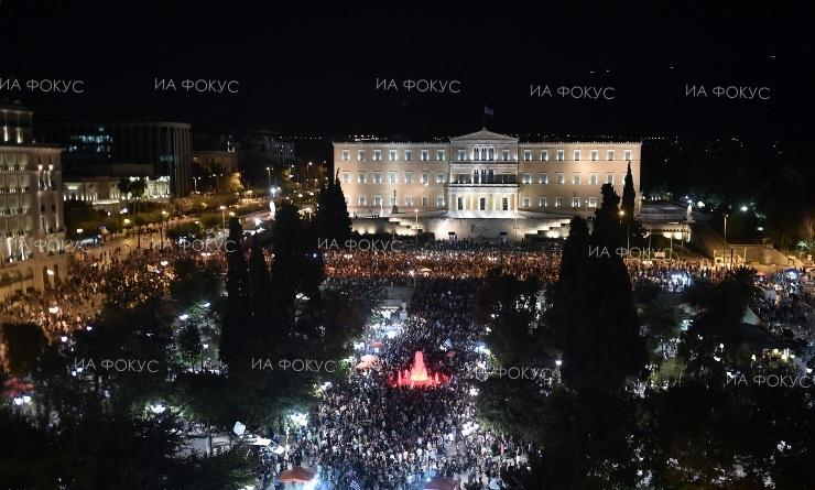 Greeks celebrate Oxi victory at Sunday referendum.