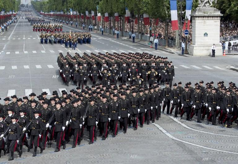 France marks national holiday with military parade.