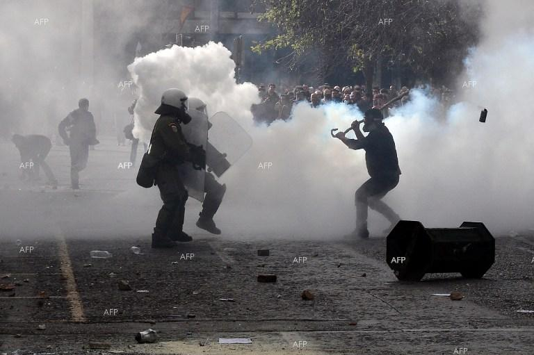 Farmers clash with police amid tear gas in front of the agriculture ministry in Athens during a demonstration.