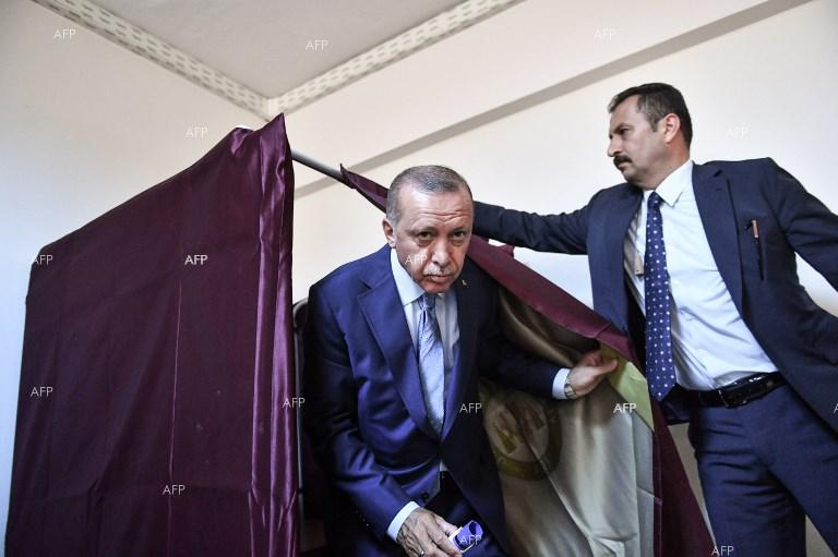 Turkish President Recep Tayyip Erdogan going out of the polling booth after casting his vote in the parliamentary and presidential elections in the country. June 24, 2018;