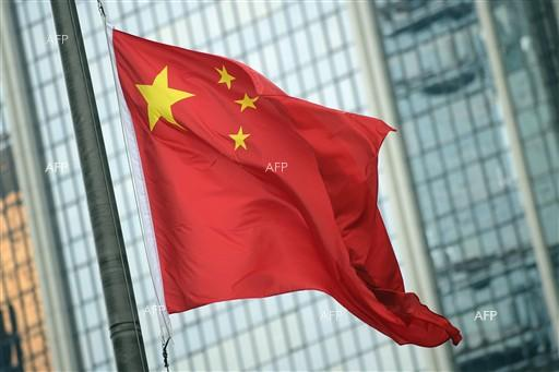 AFP: China says can't hold US trade talks with 'knife to the throat'