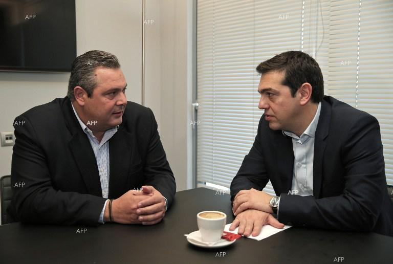 Greek Syriza leader Alexis Tsipras and Independent Greeks leader Panos Kammenos agree on forming a coalitional government.