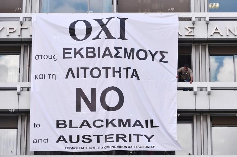 "Poster reading ""No to blackmail and poverty"" on the building of the finance ministry in Athens."