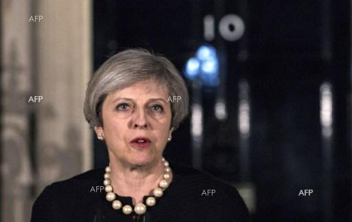 UK PM Theresa May speaks to reporters after terrorist act near UK parliament. March 23, 2017