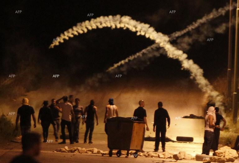 Clashes between Israeli police and Palestinians in Ramallah.
