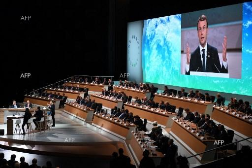 French President Emmanuel Macron holds a speech at the One Planet climate summit. December 12, 2017;
