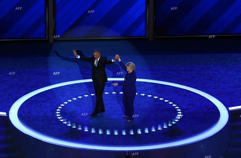 Hillary Clinton gets on stage during the Democratic National Convention in Philadelphia together with Barack Obama.