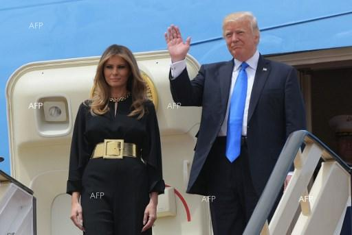 AFP: Trump lands in China for talks on trade, North Korea