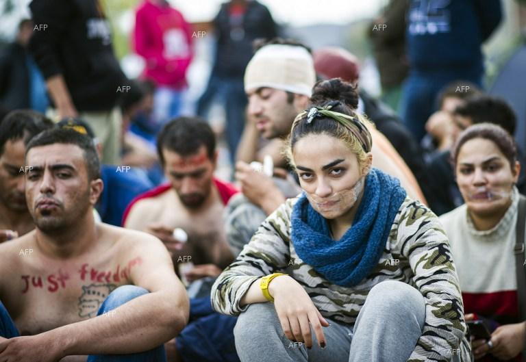 Migrants sew lips in Greek-Macedonia border protest.