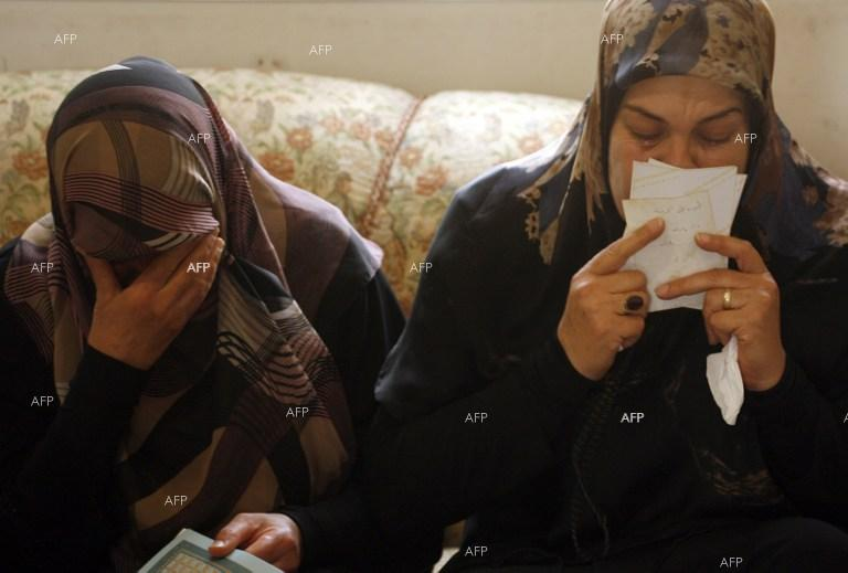 Relatives of victims of crashed Air Algerie jetliner, July 25, 2014