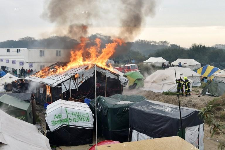 Fire at so-called Jungle migrant camp in Calais, France.