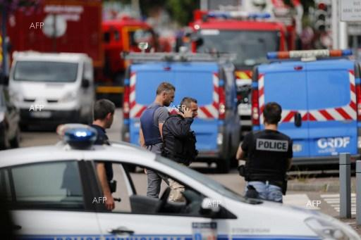 Priest killed in hostage crisis at a church in Northern France.