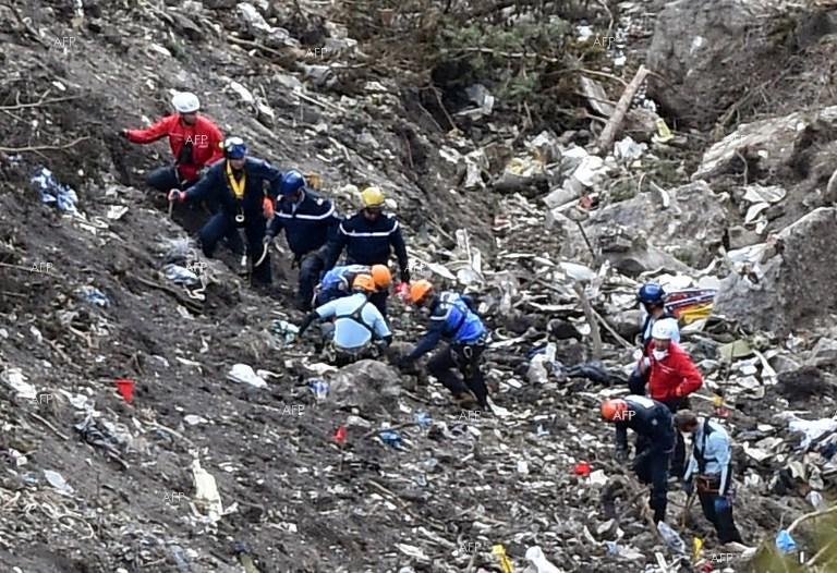 Officials comb the wreckage of the Germanwings flight that crashed into the French Alps.