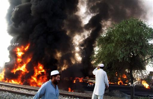 AFP: Suicide bombing kills 13 at NW Pakistan election rally