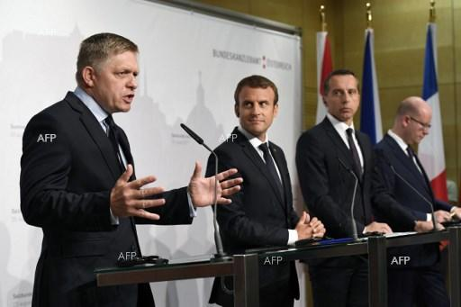 Slovak Prime Minister Robert Fico, French President Emmanuel Macron, Austrian Chancellor Christian Kern and Czech Prime Minister Bohuslav Sobotka hold a press conference in Salzburg, August 23, 2017;