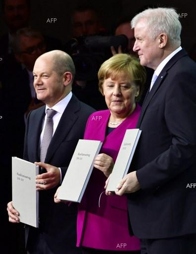 Olaf Scholz, Angela Merkel and Horst Seehofer sign official coalition agreement between CDU/CSU and SPD. March 12, 2018;