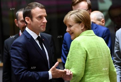 Emmanuel Macron and Angela Merkel at the EU Council meeting in Brussels, June 22, 2017.