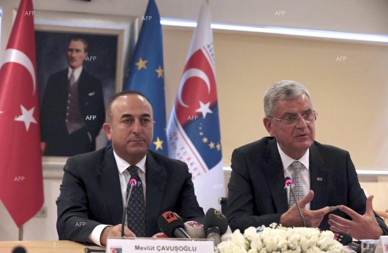 Turkish Foreign Minister Mevlut Cavusoglu and Turkish EU Affairs Minister Volkan Bozkir hold a press conference in Ankara.