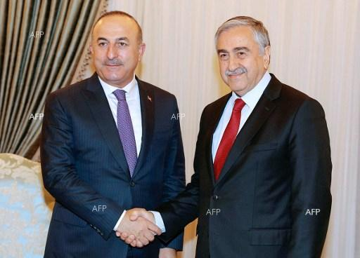 Turkish Cypriot leader Mustafa Akinci (R) with Turkish Foreign minister Mevlut Cavusoglu in the northern part of Nicosia, February 21, 2017